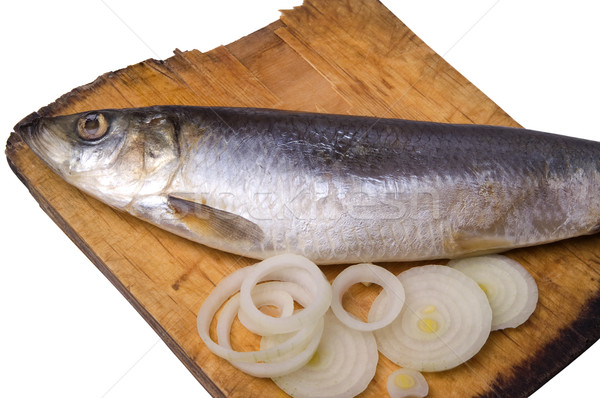 Herring with onion on old wooden board Stock photo © BSANI