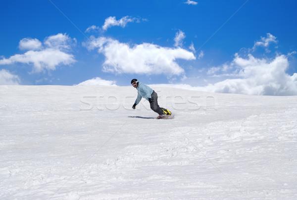 Snowboarder against blue sky Stock photo © BSANI