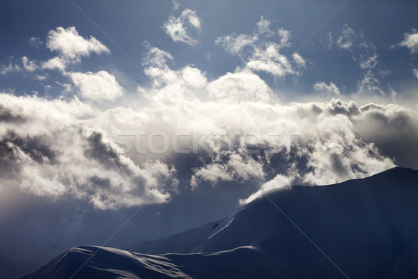 Evening mountain in haze and sunlight clouds Stock photo © BSANI