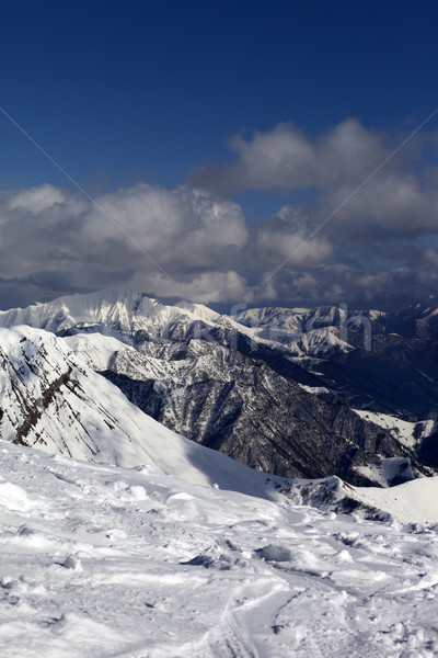 Sunlit mountains in clouds, view from off-piste slope Stock photo © BSANI