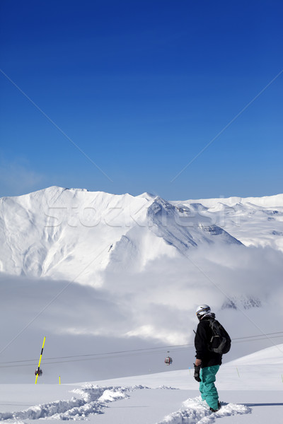 Snowboarder on off-piste slope with new fallen snow at nice day Stock photo © BSANI