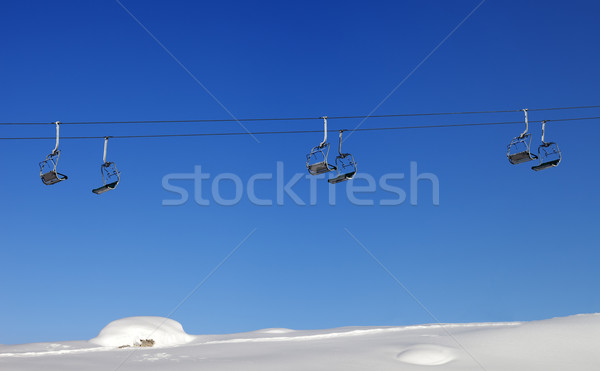 Chair-lift and blue clear sky at sun day Stock photo © BSANI