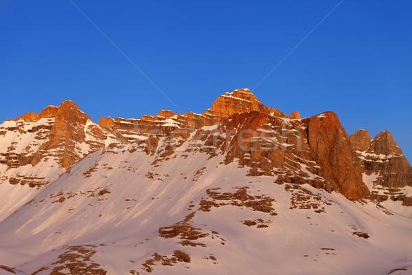 Sunrise at snowy mountains Stock photo © BSANI