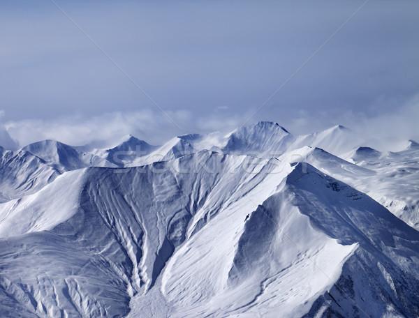 Snowy mountains in mist Stock photo © BSANI