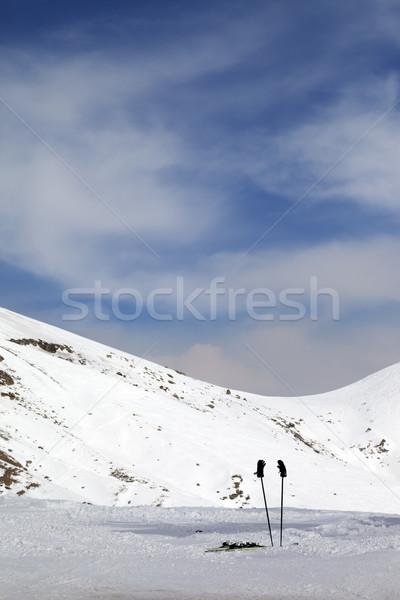 Skiing equipment on ski slope Stock photo © BSANI