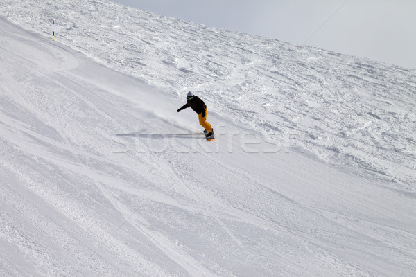 Ski slope and snowboarder at winter cold day Stock photo © BSANI