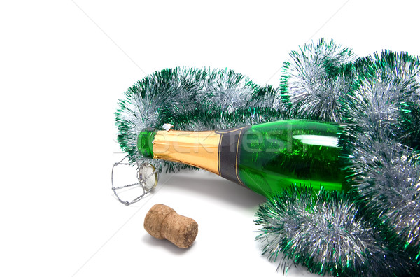 Empty bottle of champagne and Christmas tinsel  Stock photo © BSANI