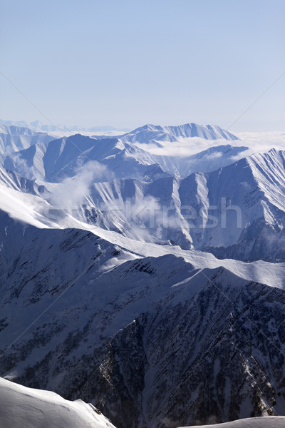 Winter mountains in haze Stock photo © BSANI