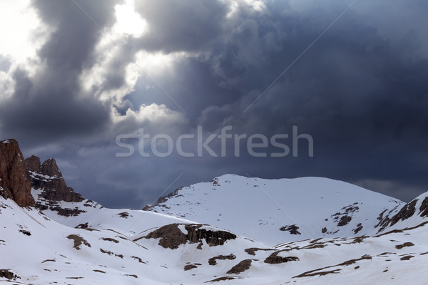 Snowy mountains and storm clouds Stock photo © BSANI