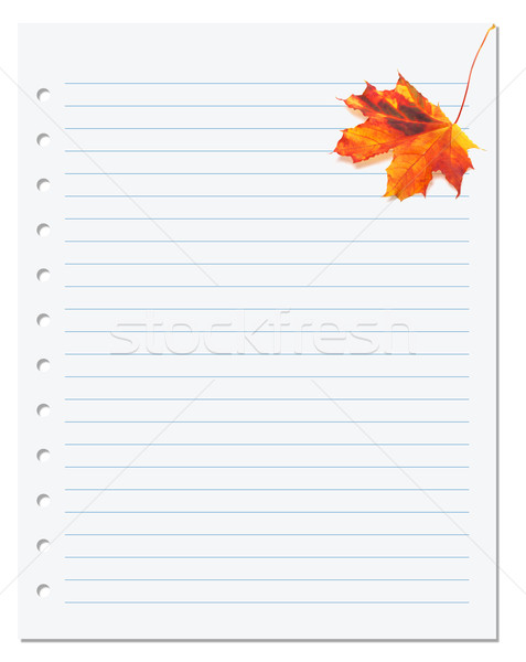 Notebook paper with orange autumn maple leaf on white Stock photo © BSANI