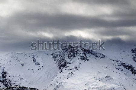 Snow mountains in haze and storm clouds before blizzard Stock photo © BSANI