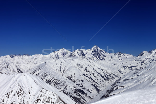 View on off-piste slope, winter snowy mountains and blue clear s Stock photo © BSANI