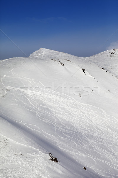Off-piste ski slope with traces Stock photo © BSANI