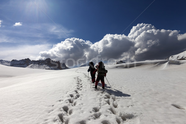 Two hikers on snowy plateau Stock photo © BSANI