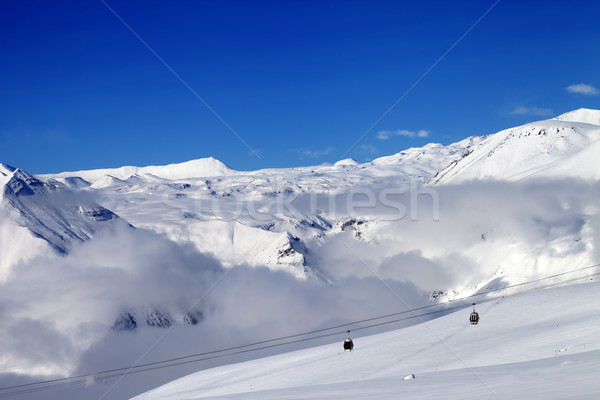 Off-piste snowy slope and cable car at sun day Stock photo © BSANI