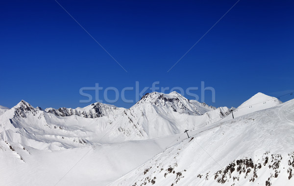 Stock photo: Off-piste slope and ropeway in nice sun day