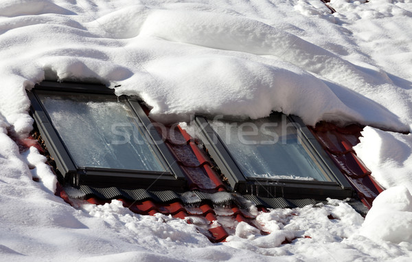 Snowy roof with icy windows Stock photo © BSANI