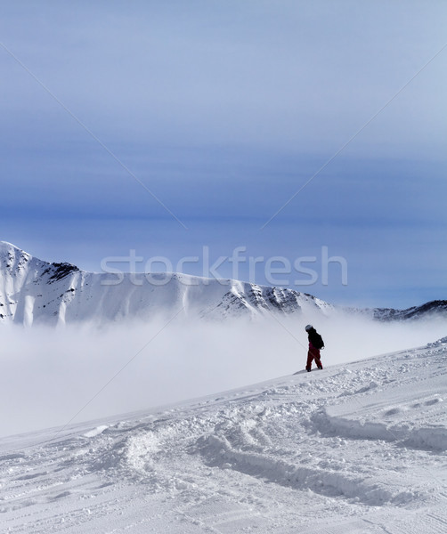 Snowboarder on off-piste slope with newly fallen snow Stock photo © BSANI