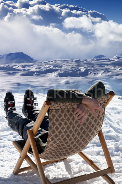 Skier at winter mountains resting on sun-lounger Stock photo © BSANI