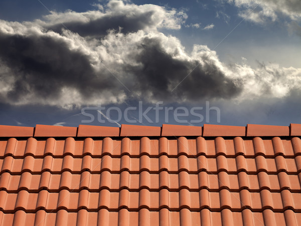 Stock photo: Roof tiles and storm sky