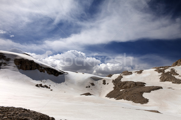 Mountains with snow cornice in nice day Stock photo © BSANI