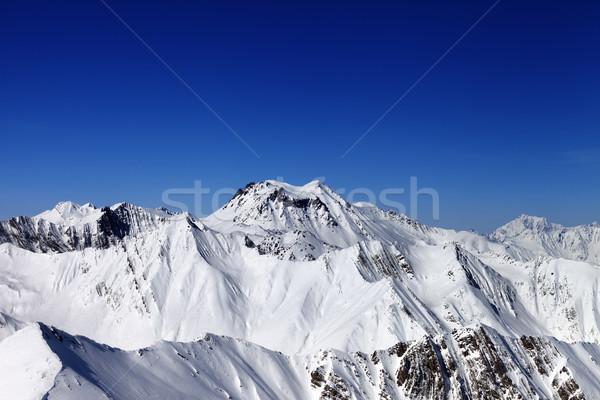 Snowy mountains in sun day Stock photo © BSANI