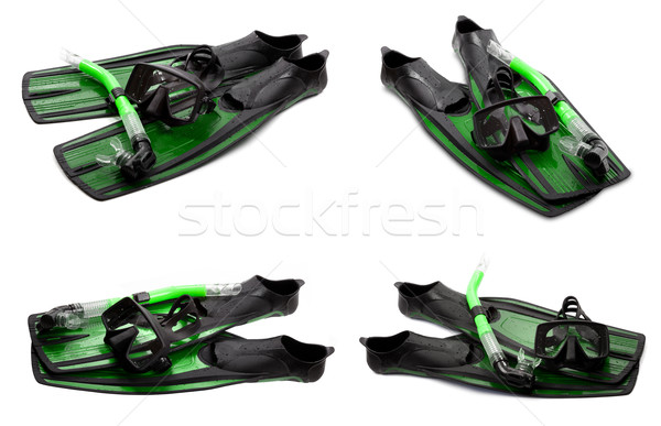 Set of green swim fins, mask and snorkel for diving on white bac Stock photo © BSANI