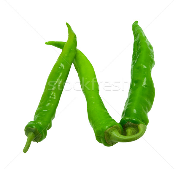 Letter N composed of green peppers Stock photo © BSANI