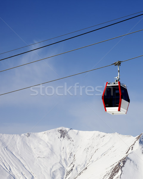 Gondola lift and snowy mountains Stock photo © BSANI