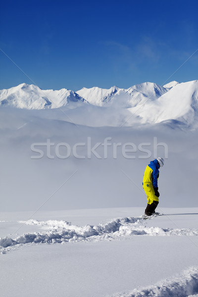 Snowboarder on off-piste slope with new fallen snow Stock photo © BSANI