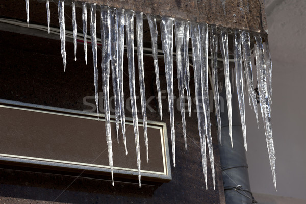 Roof of house with icicles Stock photo © BSANI