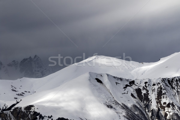 Sunlight mountains with snow cornice and trace from avalanche be Stock photo © BSANI