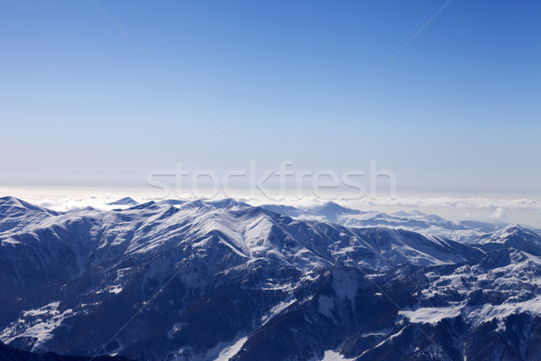 Snowy mountains in haze at morning Stock photo © BSANI
