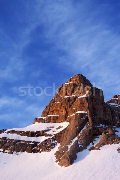 Snowy sunlight rocks at sunrise Stock photo © BSANI