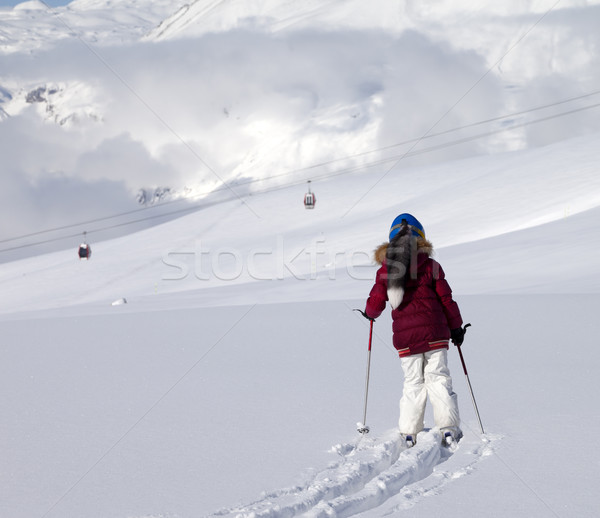 Girl on skis in off-piste slope with new fallen snow at sun day Stock photo © BSANI