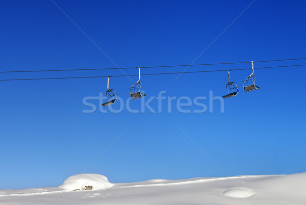 Chair-lift and blue clear sky at sunny day Stock photo © BSANI