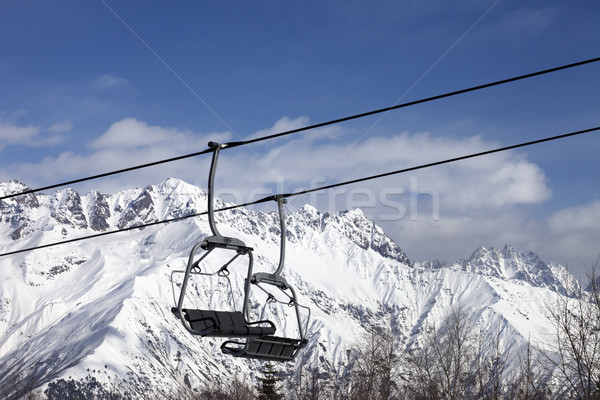 Chair lift in snowy mountains at nice sunny day Stock photo © BSANI
