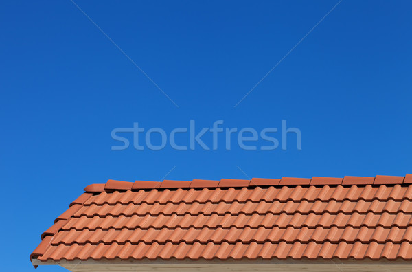Roof tiles and blue clear sky Stock photo © BSANI