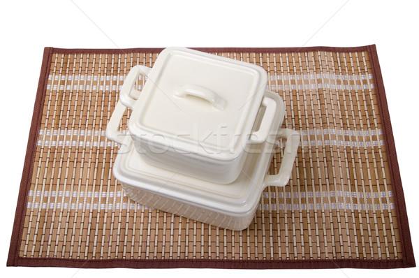 Ceramic pots for stove on bamboo mat Stock photo © BSANI