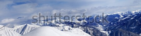 Panorama of off-piste snowy slope and cloudy mountains Stock photo © BSANI