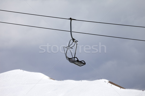 Chair lift and off-piste slope at gray day Stock photo © BSANI