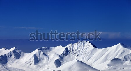 Snowy mountains at sunny day. Panoramic view Stock photo © BSANI