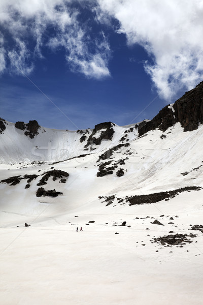 Hikers in snowy mountains Stock photo © BSANI