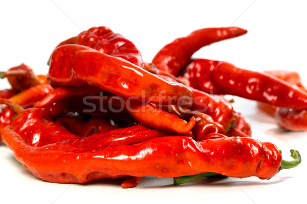 Red chili peppers with water drops on white background Stock photo © BSANI
