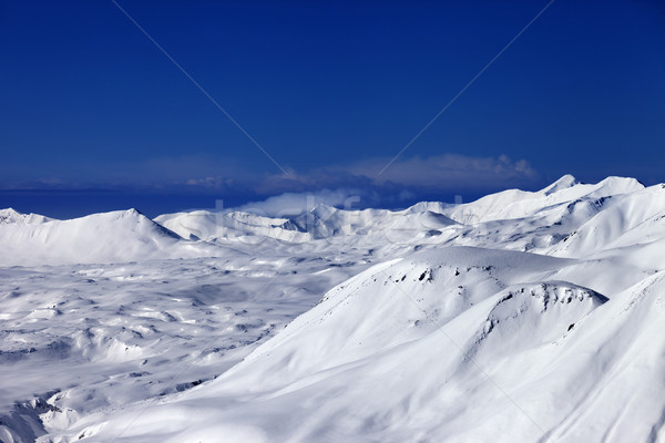 Off-piste slope and snowy plateau at nice day Stock photo © BSANI