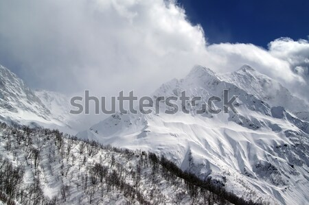 Mountains in evening cloudy sky Stock photo © BSANI