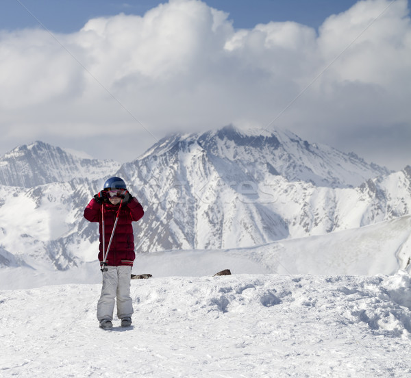 Little skier on top of ski slope at sun day Stock photo © BSANI