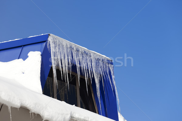 Snowy attic with icicles Stock photo © BSANI