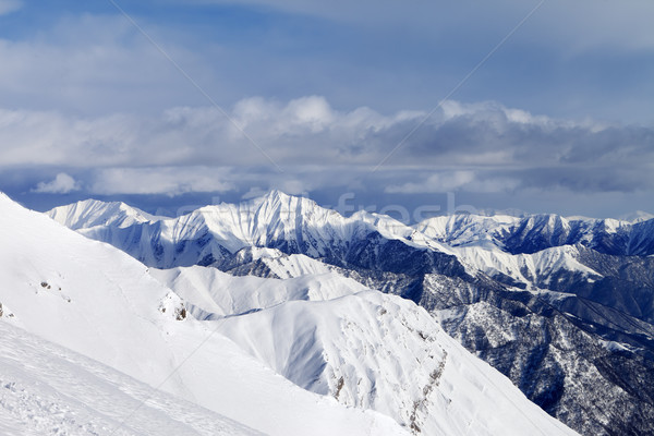 Off-piste slope and snowy mountains Stock photo © BSANI