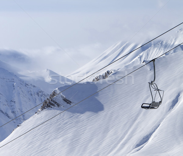 Chair lift and mountains in fog Stock photo © BSANI